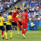 Harry Maguire heads home England's opener against Sweden (Owen Humphreys/PA)