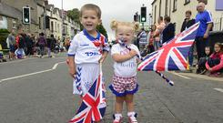 Mia and Callum Robinson pictured as the parade passes through Ballyclare town. Picture By: Arthur Allison.