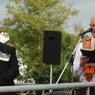 County Down Grand Secretary Richard Fleming (District Chaplain of Lower Iveagh West District LOL No 8) pictured reading a portion of Scripture at an act of remembrance at the War Memorial following the drummers tribute at Donaghcloney on Tuesday 10th July. Included is Thomas Walker, President of the Donaghcloney Branch of the Royal British Legion (left) who gave the exhortation.