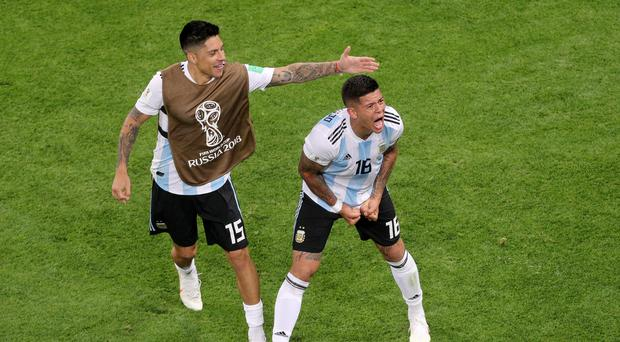 Marcos Rojo cannot hide his delight as he puts Argentina in front against Nigeria (Owen Humphreys/PA)