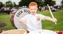 Dean Campbell of Plumbridge Eden LOL 39 practices his drum work ahead of the Castlederg parade. Picture by Trevor Lucy for Belfast Telegraph.