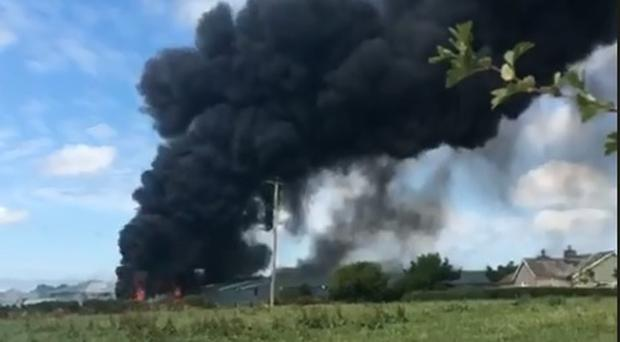 Thick black smoking coming from a tyre fire in Dromore. Credit: Ben Tucker