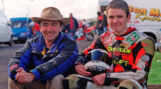 PACEMAKER, BELFAST, 1/11/2000: Robert Dunlop with his son, William (16). William rode his Dad's 125cc Honda for his first taste of racing at Aghadowey recently.