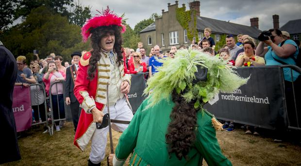 Crowds gather as King William (played by John Adair) is victorious in the Sham Fight with King James (Colin Cairns) at Scarva on July 13th 2018 (Photo by Kevin Scott for Belfast Telegraph)