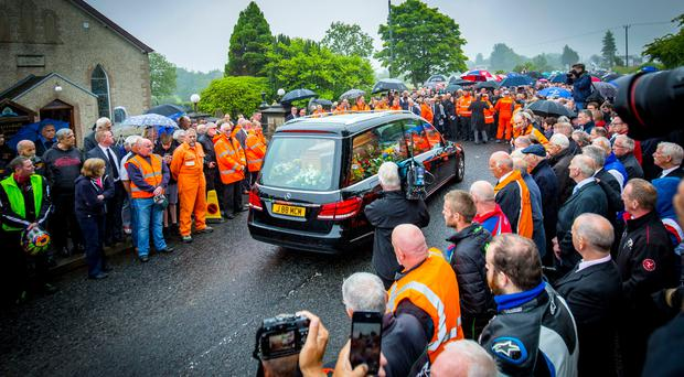 Tragic loss: mourners gather as the coffin of William Dunlop is carried into Garryduff Presbyterian Church