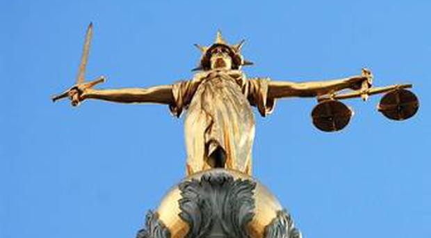 A man charged with verbally abusing police after being told to pick up a smashed bottle at a Twelfth parade must remain in custody, a judge ruled yesterday