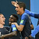 Samuel Umtiti (second left) was on target against Belgium as France booked their place in the 2018 World Cup final. (Martin Meissner/AP)