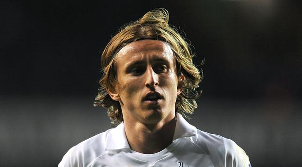 Luka Modric played for Tottenham for four years (Dominic Lipinski/PA)