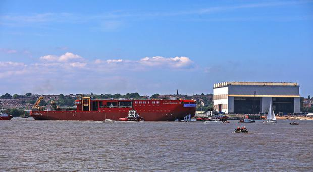 The RRS Sir David Attenborough polar research ship's hull is launched in the River Mersey (Peter Byrne/PA)