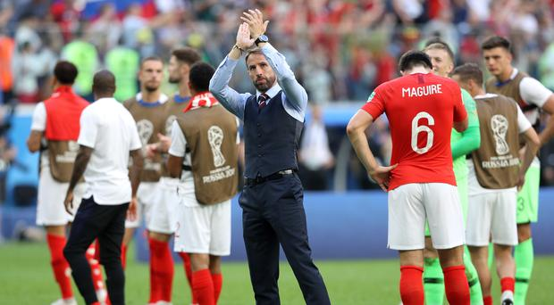 The England squad and Gareth Southgate will not return to fanfare on Sunday (Owen Humphreys/PA)