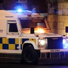 A police vehicle on Fahan street in Londonderry after it was petrol bombed (Brian Lawless/PA)