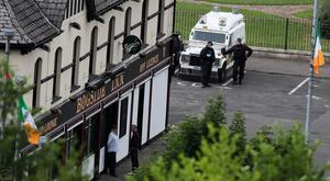 PSNI conduct searches in the Bogside area of Londonderry (Brian Lawless/PA)