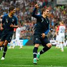 Antoine Griezmann celebrates putting his side ahead from the spot.