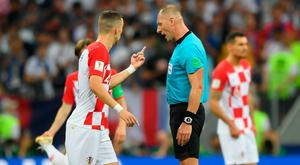 Ivan Perisic of Croatia argues with referee Nestor Pitana after he awards France a penalty.