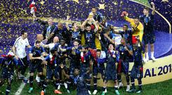 France celebrate with the trophy after winning the World Cup final (Aaron Chown/PA)