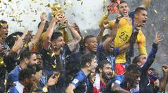 France celebrate with the trophy after winning the FIFA World Cup final at the Luzhniki Stadium (Owen Humphreys/PA)