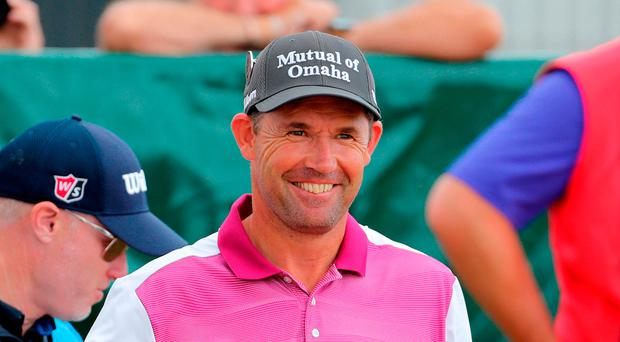Happy return: Padraig Harrington back on the course at Carnoustie yesterday, scene of his 2007 Open triumph