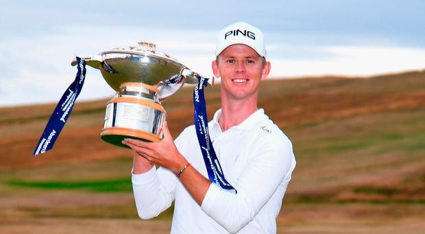 Victor's spoils: Brandon Stone with his trophy after winning the Aberdeen Standard Investments Scottish Open title