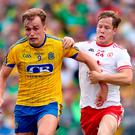 Hands on: Roscommon's Enda Smith is pursued by Kieran McGeary