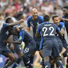 France players celebrate after winning a thrilling World Cup final 4-2 (Martin Meissner/AP)