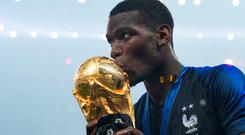 Paul Pogba celebrates with the World Cup trophy after scoring in Sunday's final against Croatia.