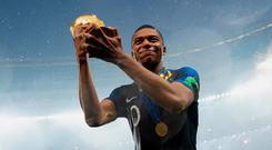 France's Kylian Mbappe celebrates with the World Cup trophy after winning the 2018 tournament.