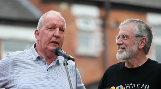 Bobby Storey and Gerry Adams address a rally (Niall Carson/PA)
