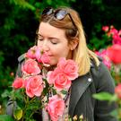 Jenna Gardiner enjoys the fragrant roses
