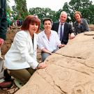 From left: Minister for Culture, Heritage & the Gaeltacht Josepha Madigan; Dr Cliodhna Ni Lionain; Devenish's Owen Brennan, and Professor Alice Stanton with some of the pieces of unearthed kerbstone from the tomb in Co Meath