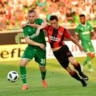 Battle: Paul Heatley tries to get past Ludogorets' Cosmin Moti in last week's first leg
