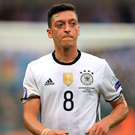 Up against it: Mesut Ozil struggled at World Cup