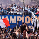Party time: the French players, who won the World Cup on Sunday, celebrate with their fans on Champs-Elysee after returning to Paris yesterday