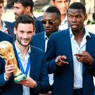 Prize: Hugo Lloris (left) next to Paul Pogba in Paris yesterday