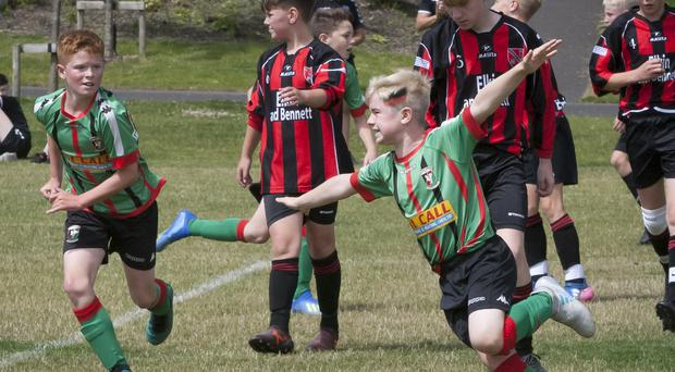 Glentoran's Jack Hastings celebrates in style against Lisnaskea Rovers during Monday's u-12 O'Neills Foyle Cup game.