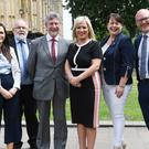 Sinn Fein leader Michelle O'Neill (third right) with the party's MPs, from left, Orfhlaith Begley, Francie Molloy, Mickey Brady, Michelle Gildernew and Paul Maskey in Westminster