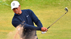 Taking flight: Tiger Woods at Carnoustie yesterday