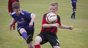 Action from Hillsboro Boys (Lisburn) and Larne Youths at Templemore Sports Complex during Tuesday's O'Neills Foyle Cup fixture.