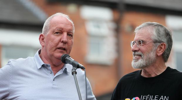 Bobby Storey (left) and Gerry Adams address a rally (Niall Carson/PA)