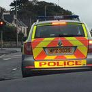 A police vehicle in Larne was spotted with a defective light. Credit: PSNI