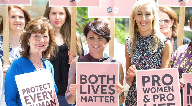 Founder of Both Lives Matter Dawn McAvoy (centre) and MLA Carla Lockhart (right) join Northern Irish women at Victoria Tower Gardens in London (Ominic Lipinski/PA)
