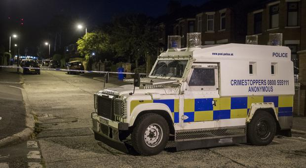 Police at the scene of an explosive device attack on the west Belfast home of Gerry Adams (Liam McBurney/PA)