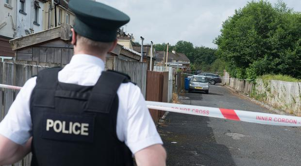 Police at the scene of Tuesday night's pipe bomb attack at Bann Drive in Derry