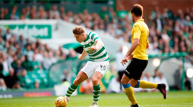 Three and easy: James Forrest scores Celtic's third goal, but boss Brendan Rodgers is left short in defence after Jozo Simunovic's red card