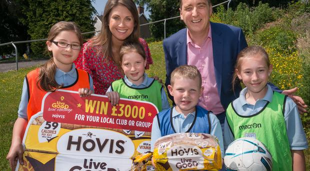 Trevor McCrum, Commercial Director, Hovis Ireland and Independent Judge Sarah Travers are pictured with L-R Sarah Jane Sufferin (10), Erin Lennox (8), Calum Boreland (8) and Hannah Sufferin (11) from Ampertaine Primary School.