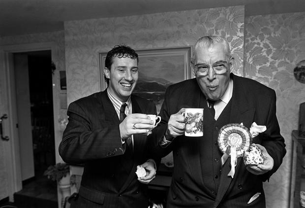 Ian Paisley and Ian jnr eating buns in the campaign trail in March 1982.