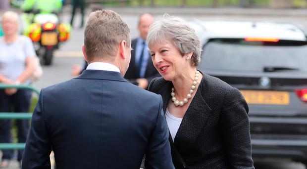 Prime Minister Theresa May is greeted by Managing Director of Belleek pottery factory John Maguire - Credit: Niall Carson/PA Wire