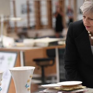 Prime Minister Theresa May during a visit to Belleek pottery factory on the northern side of the border between Enniskillen in Northern Ireland and Ballyshannon in Donegal (Clodagh Kilcoyne/PA)