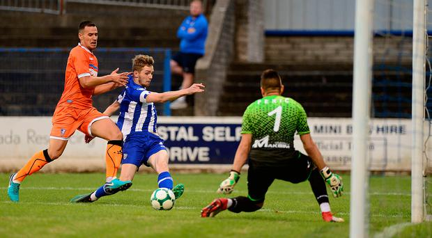 On attack: Coleraine striker Jamie McGonigle battles with Subotica's Branimir Jocic last night at the Showgrounds