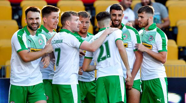 Spot on: Joe Gormley is mobbed after putting Cliftonville ahead from the penalty spot in Denmark last night