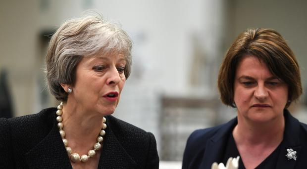 Theresa May, pictured in Northern Ireland with DUP leader Arlene Foster, will tell the EU to 'evolve' its thinking on Brexit, including over border issues and the customs backstop (Clodagh Kilcoyne/PA)